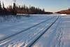 Looking along tracks towards Moosonee station from winter road crossing.