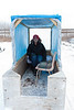 Sofia Ashraf sitting in the sled of a snowmobile taxi.
