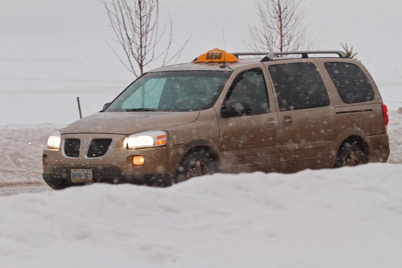 Taxi on Revillon Road in snow storm 2011 April 4th.