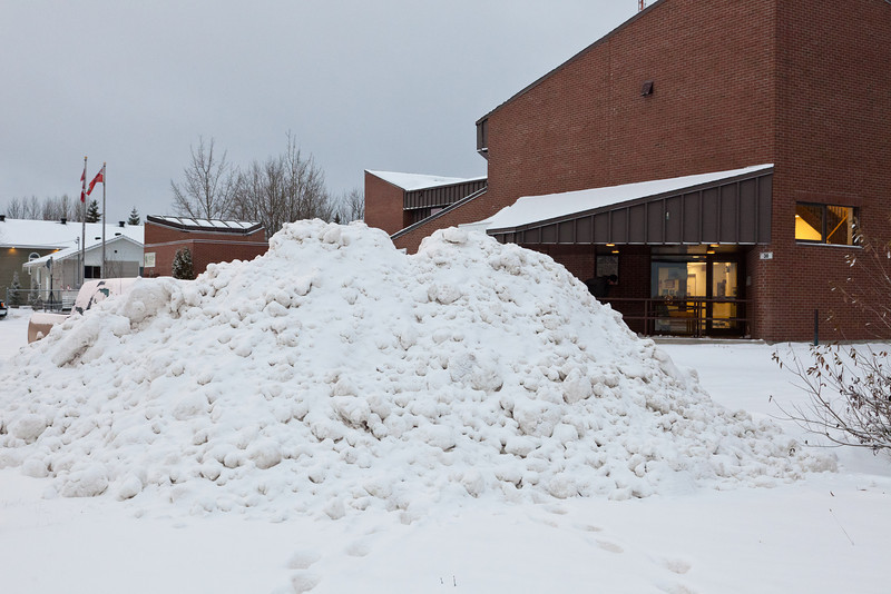 Pile of snow at Government Building parking lot.