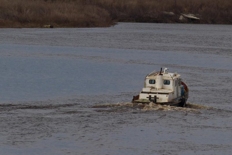 Small tug heads up the Moose River at Moosonee