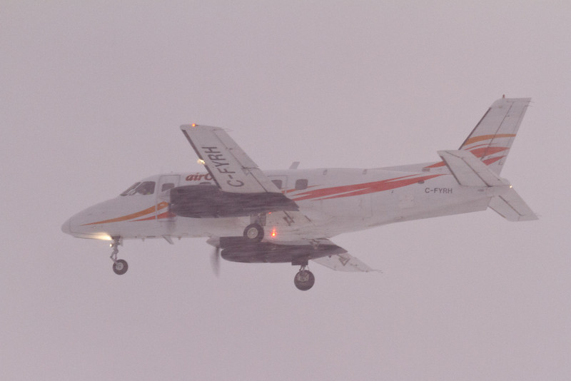Aircreebec Embraer EMB-110P1 Bandeirante coming in over the Moose River to land at Moosonee, Ontario.