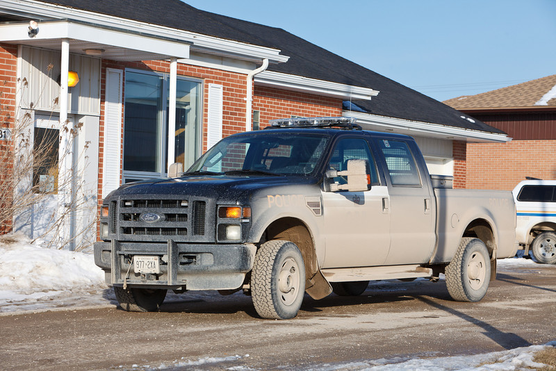 Moosonee does not have paved roads. Despite the best efforts of the Ontario Provincial Police vehicles often endup covered in mud and dust before they can be washed again.