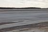 Water along the shore in Moosonee.
