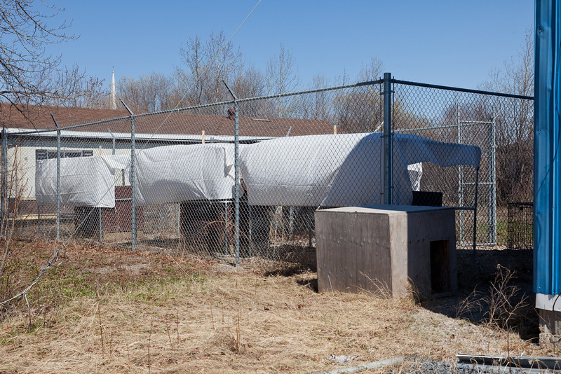 Cages behind fire hall.