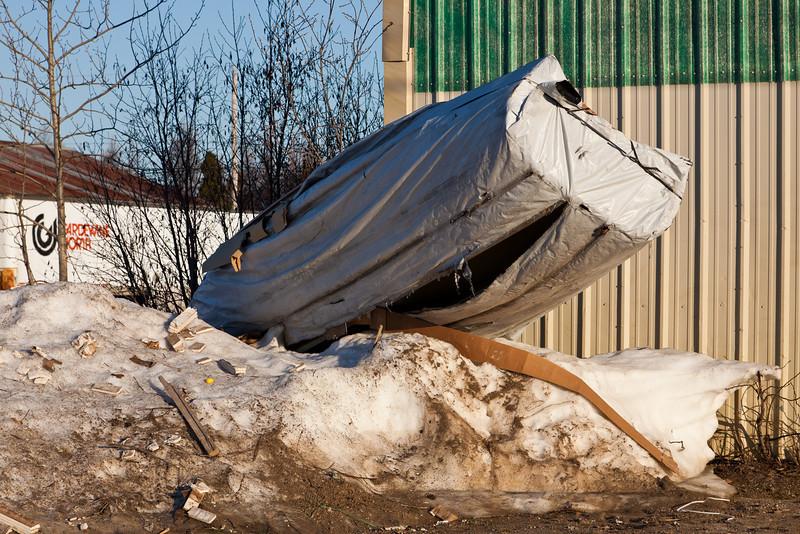 Canoe on pile of snow