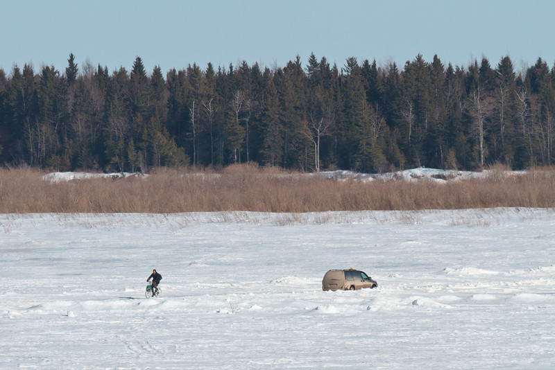 Brian O'Neill, an articling student at Keewaytinok Native Legal Services in Moosonee, Ontario bicycles back to Moosonee from the clinic's satellite office in Moose Factory across the Moose River (North Road) 2011 March 29th.