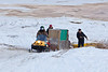 Snowmobile taxi stuck at the bottom of McCauley's Hill in Moosonee. Passengers include Keewaytinok Native Legal Services student at law Sofia Ashraf.