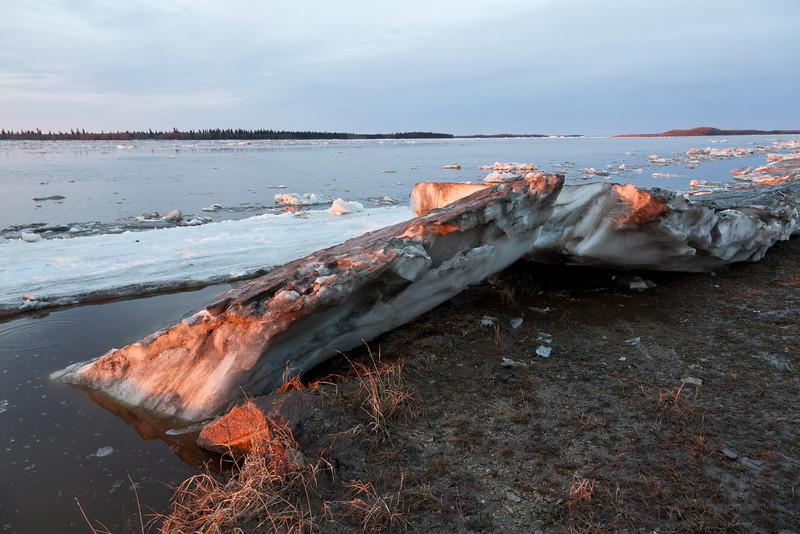 Ice sheet at an angle along the shoreline. Note the granite rock underneath.