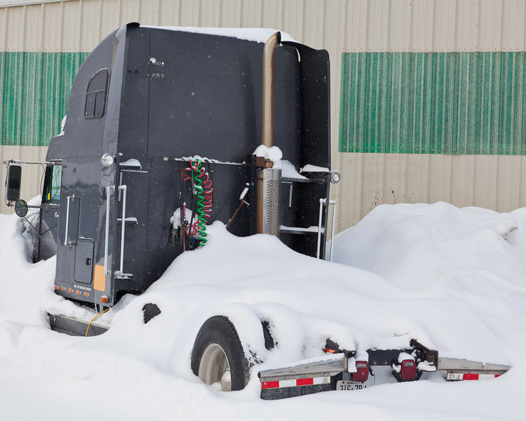 Snow covered transport truck