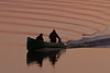 Canoe on the Moose River just before sunset, with curved ripples.