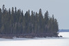 South end of Butler Island seen from near Moosonee Airport 2011 April 21st, shot into the sun.