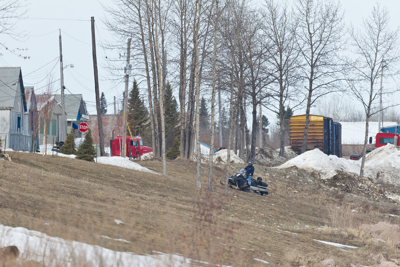 Snowmobile on the Moose River 2011 April 23rd coming to Moosonee and up the river bank