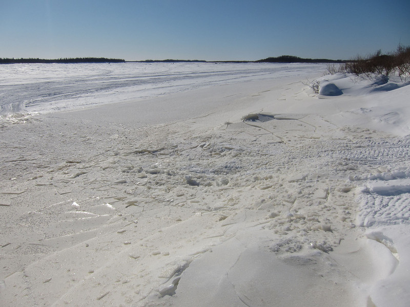 2011 February 21 along the edge of the Moose River showing cracked ice along the tide mark.