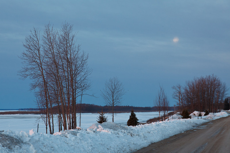 Moon in the morning sky around sunrise 2011 April 20th view up Revillon Road