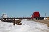 Trucks on flatcars at Airport Road loading platform.