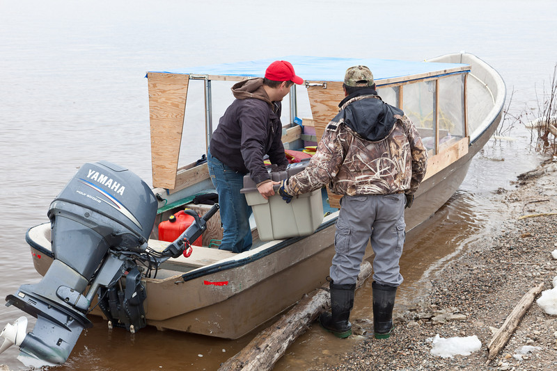 Roger Nakogee arriving with boat taxi in Moosonee