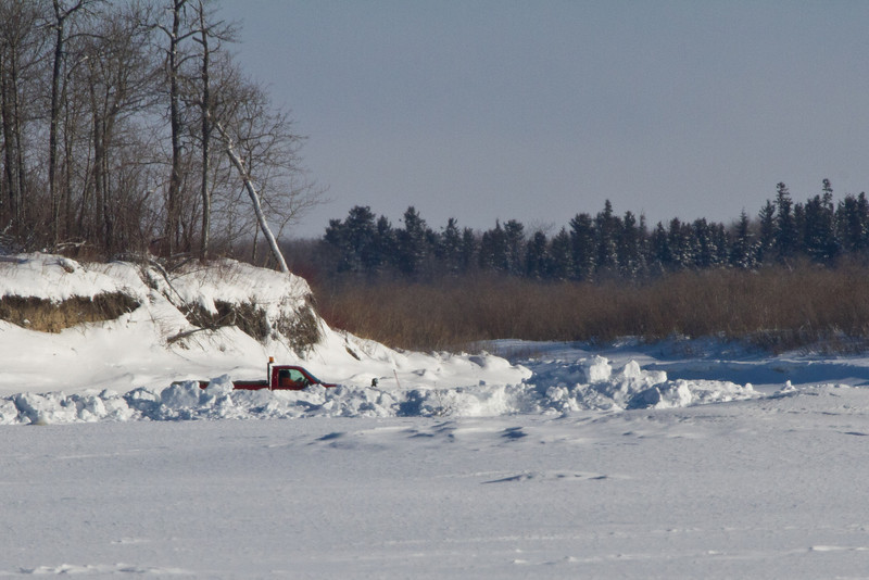 Truck passing Butler Island on way to Moose Factory.