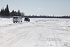"""Traffic on the """"north"""" winter road from Moosonee to Moose Factory."""