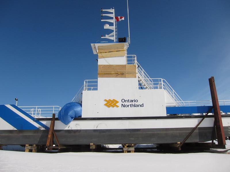 Barge Niska I in winter storage along the Moose River.