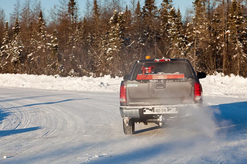 Truck heading north on winter road.