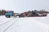 Float truck on winter road south gong over track crossing in Moosonee.