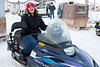 Sofia Ashraf sitting on a snowmobile used in taxi service between Moosonee and Moose Factory.