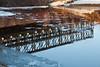 Reflection of Airport Road bridge in Butler Creek