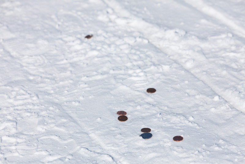 Coins on sidewalk. Picture 1. On the way to the train station.