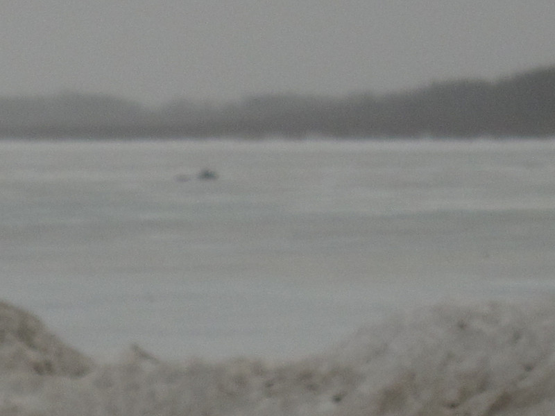 Snowmobile in the rain on the Moose River 2011 Aprill 11