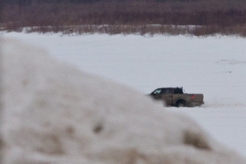 """Truck coming across the Moose River 2011 April 4th on """"north"""" road."""