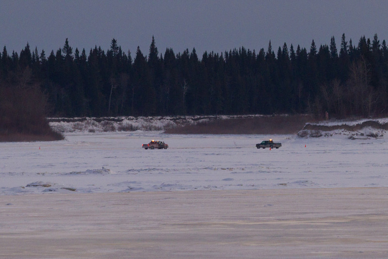 Work vehicles on the winter road between Moosonee and Moose Factory across the Moose River. Seen here at the entrance to the Gutway.