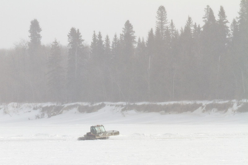 Working on a road across the Moose River.