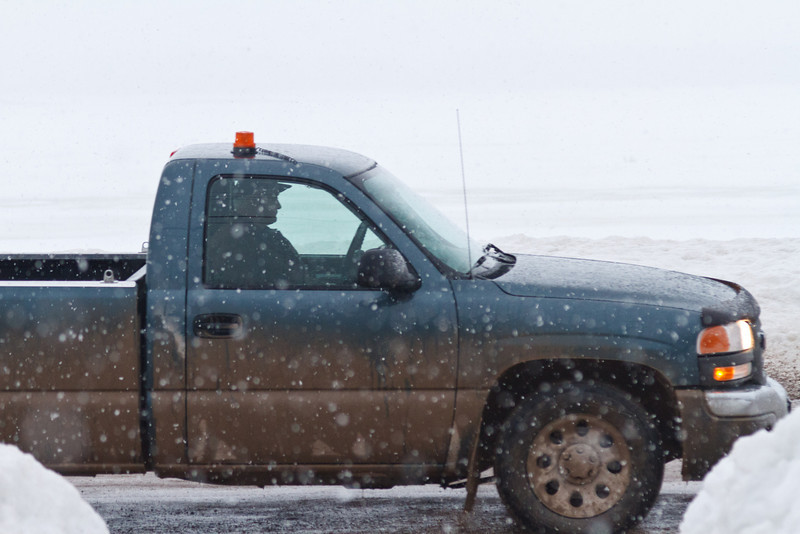 Truck on Revillon Road in snow storm, front section of truck visible only 2011 April 4th.