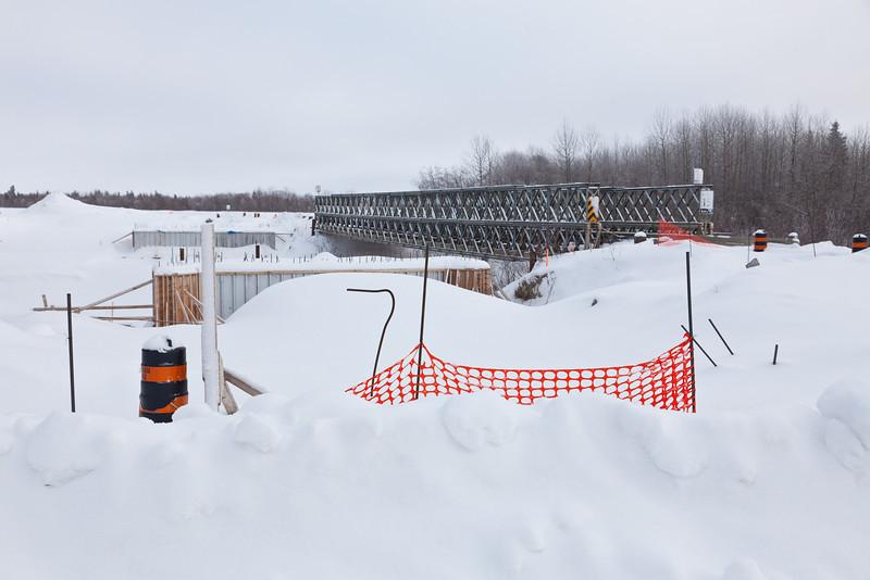 Work suspended on new bridge to replace Bailey Bridge across Butler Creek in Moosonee.