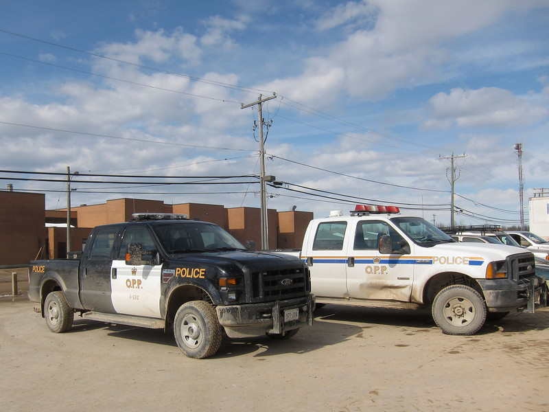 Old and new Ontario Provincial Police paint schemes at Northern Store. Note staggered parking by officers that does not block any other vehicles.