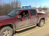 Trina Hookimaw in her truck on Ferguson Road bridge 2011 April 21