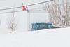 Truck behind snowbanks on Revillon Road.