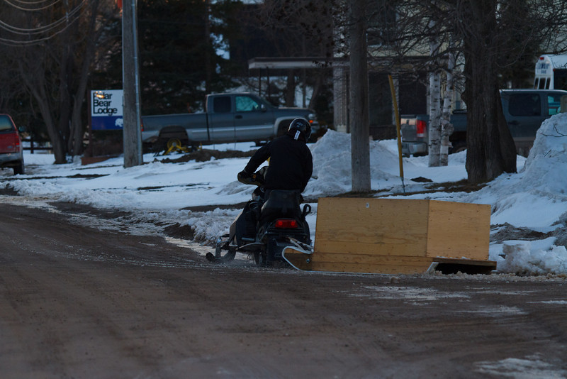 Snowmobile turning on to Revillon Road. 2011 April 19th