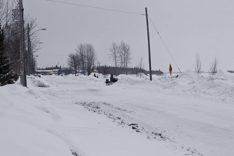 Snowmobile crossing Revillon Road