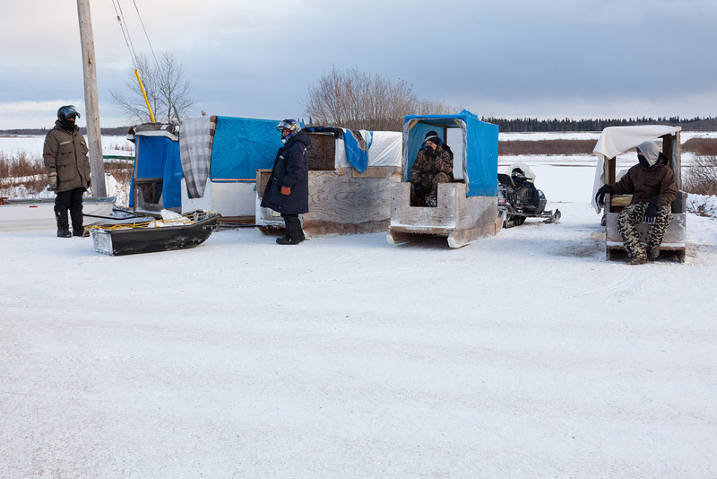 Snowmobile taxi in Moosonee waiting for passengers to take to Moose Factory.