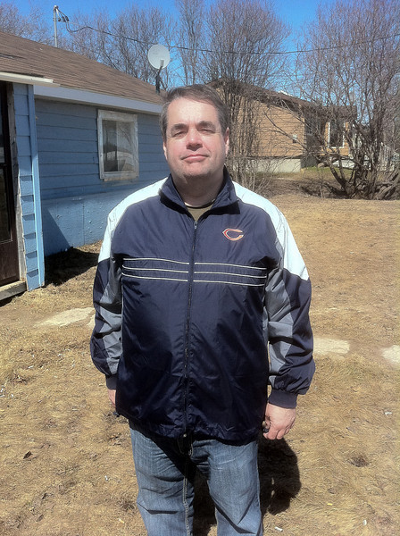 Paul in Chicago Bears jacket he got for subscribing to Sports Illustrated.