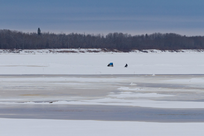 Snowmobiles on the Moose River.