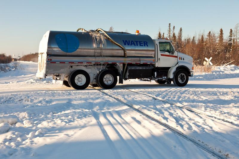 Traffic on winter road that runs north from Moosonee at crossing of Ontario Northland Railway tracks.