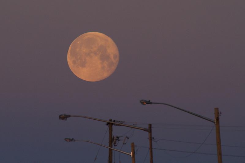 Moon over morning streetlights