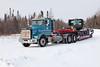 Float truck on winter road south approaching track crossing in Moosonee.