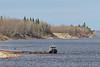 2011 May 11 small tug Harricanaw River anchored in the Moose River at Moosonee, Ontario