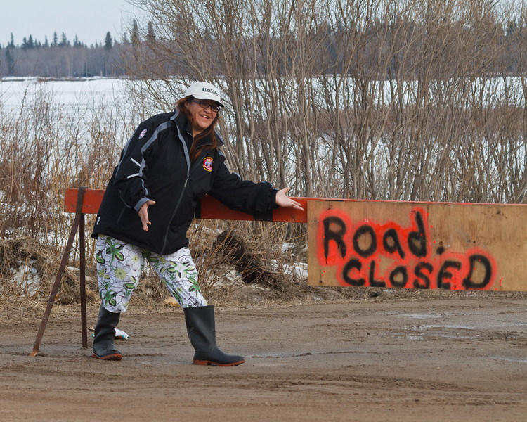 Denise Metatawabin by road closed sign at McCauley's Hill