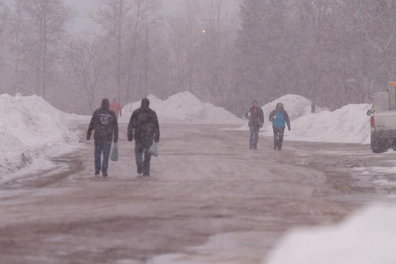 Pedestrians on Revillon Road in snowstorm.
