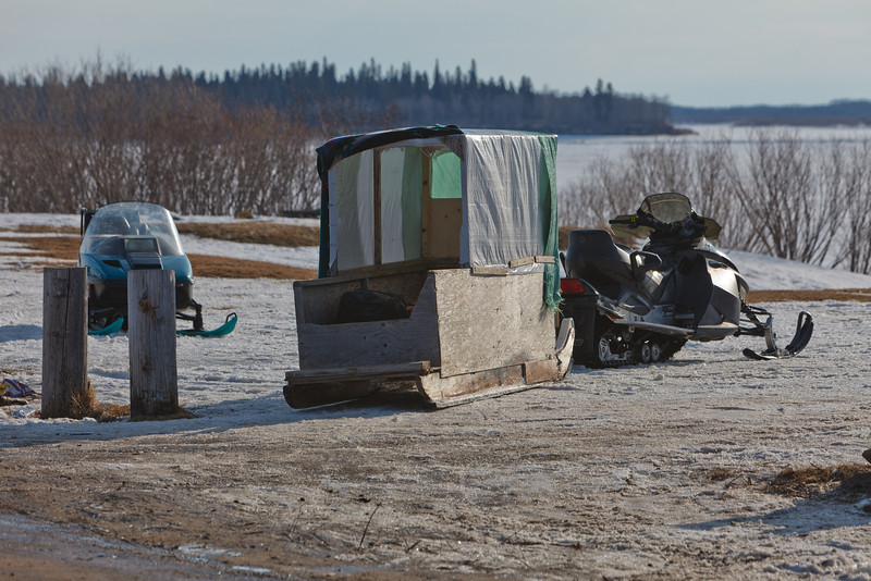 Snowmobile taxis at the top of McCauley's Hill in Moosonee. These transport passengers between Moosonee and Moose Factory at rates lower than those charged by helicopters.